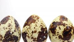 Dolly shot of quail eggs on white background Stock Footage