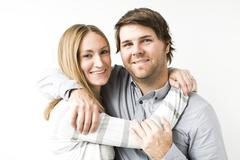 Mid-adult couple embracing - stock photo