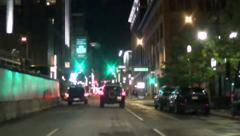 Bright city street at night Stock Footage