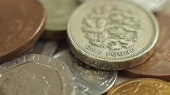 One pound coin and coins of different countries, close up. Stock Footage