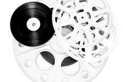 Different movie film  reel isolated on white - stock photo