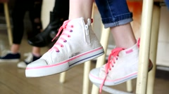 Girly legs in sneakers - stock footage