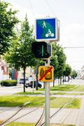 Tramway semaphore with instruction to bikers in green city urban area Stock Photos