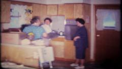 2121 - women prepare a family reunion holiday dinner - vintage film home movie Stock Footage