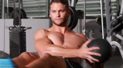 Fit man doing twist exercise at crossfit gym Stock Footage