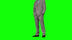 Businessman standing with hands in pockets Stock Footage
