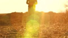 Farmgirl Walking in Dry Dusty Land Stock Footage