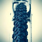 Front wheel of a mountain bike Stock Photos