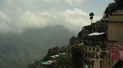 View of cloudy mountains from Gangtok, Sikkim, long shot, pan left Stock Footage