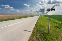 Driving on an empty road and sign at sunny day Stock Photos