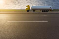Side view on tank truck in motion blur on motorway - stock photo