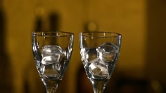Barman making cocktails at the night club, using two glasses with ice, and - stock footage
