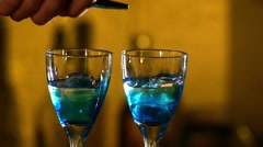 Barman making cocktails at the night club, using two glasses with ice adding Stock Footage