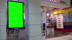 Green billboard for your ad at cellphone store Stock Footage