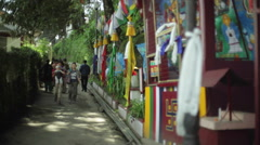 People walking next to buddhist temple, Sikkim, shallow DOF Stock Footage