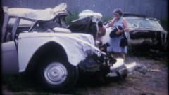 2127 - car damage after wreck injured family member - vintage film home movie Stock Footage