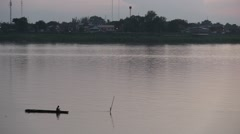 Boat with fisher man in the Mekong river in Vientiane Stock Footage
