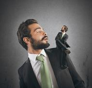Businessman and his conscience - stock photo