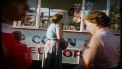 Stock Video Footage of 2129 - popcorn & vendor stand at a crowded state fair - vintage film home movie
