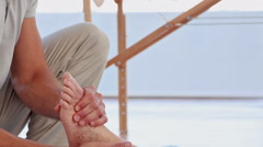 Doctor massaging his patients ankle - stock footage