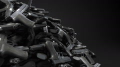 Pile of guns rotating loop Stock Footage