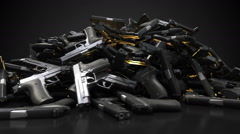 Pile of guns rotating loop Stock Footage