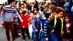 Portugal Braga school kids crossing zebra cross with teacher Stock Footage