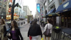 People walking in Wacker Drive with Chicago Theatre background Stock Footage