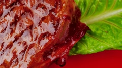 Bbq : beef (pork) steak garnished with green lettuce and red pep Stock Footage
