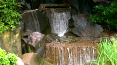 Small carved stone feng shui Japanese garden waterfall Stock Footage