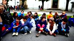 Portugal Braga school kids sitting on floor Stock Footage