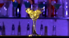 Barman making cocktail in a glass using ice and alcohol liquid, on bar, slow Stock Footage