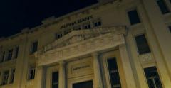 Alpha Bank Greece at night Stock Footage