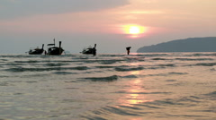 Time-lapse of travelers wading towards wooden long-tail boats floating near a Stock Footage