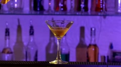 Barman pouring a liqueur and mixing two differernt alcohol liquids cocktail into Stock Footage