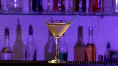 Barman pouring a liqueur and mixing two differernt alcohol liquids cocktail into - stock footage