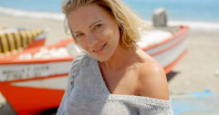 Smiling Woman Wearing Grey Sweater at Beach Stock Footage