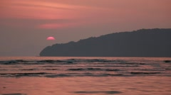 Sun setting behind Andaman Sea in Ao Nang, Krabi, Thailand Stock Footage