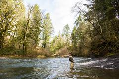 Caucasian fisherman fly-fishing in river Kuvituskuvat