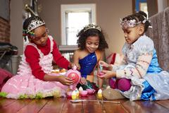 Girls playing dress-up at tea party Stock Photos