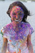 Caucasian woman splattered with paint powder Stock Photos