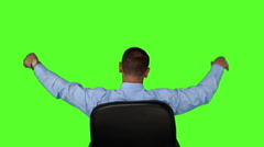 Businessman sitting in swivel chair - stock footage