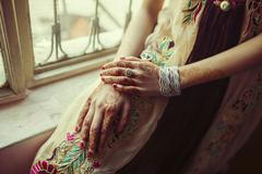 Mixed race girl with henna tattoos on hands Stock Photos