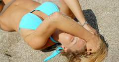 Woman Shielding Eyes from Sun with Arm on Beach Stock Footage