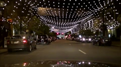 Bright city street at night Stock Footage