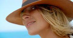 Blond Woman Wearing Hat by Breezy Ocean Stock Footage