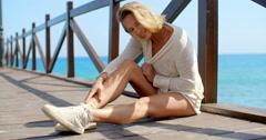 Blond Woman Wearing White Sweater on Ocean Pier - stock footage