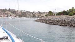 Sailing toward Dana Point California Boat Harbor Stock Footage