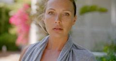 Woman Wearing Grey Robe Outdoors in Garden Stock Footage