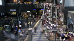 Time lapse of Students in school unifroms using escalators at Kyoto station - stock footage